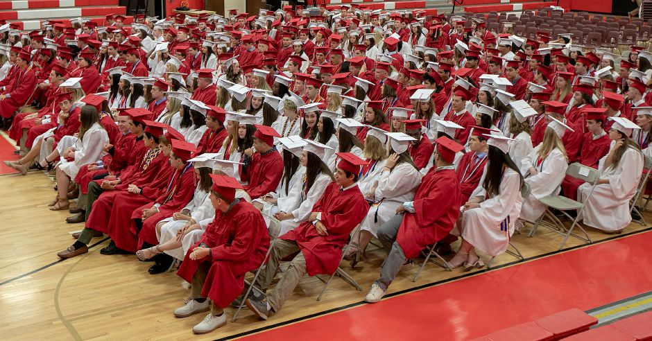 Graduates gather in the school gymnasium before the start of graduation ceremonies at Cheshire High School, Thurs., June 13, 2019. Dave Zajac, Record-Journal
