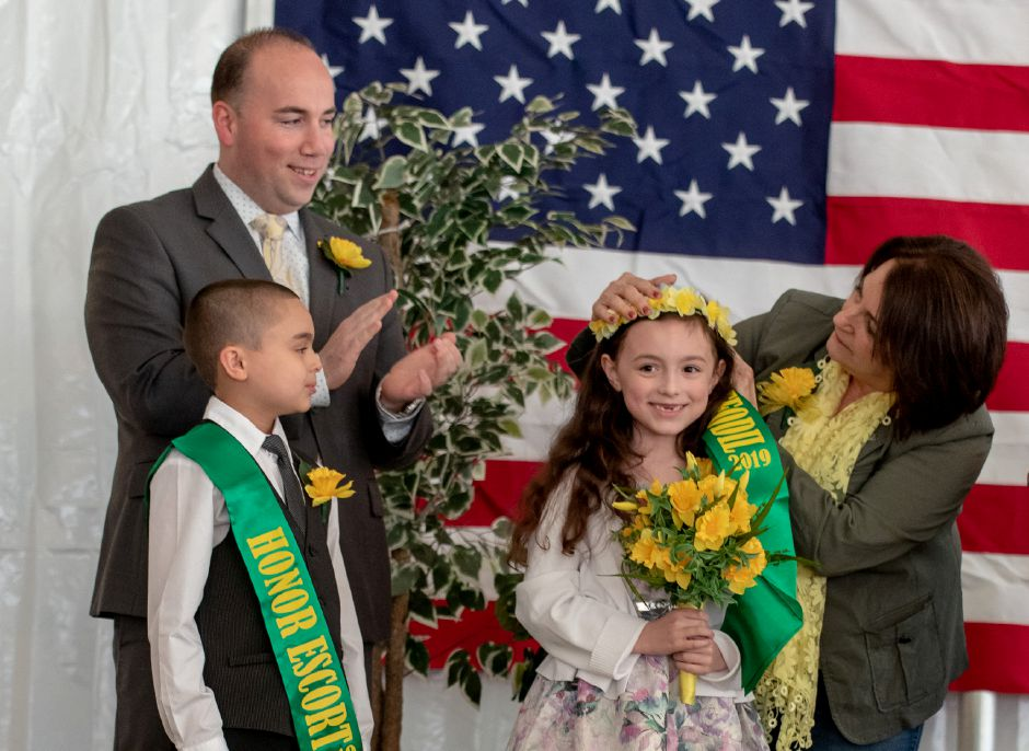 Ben Franklin Elementary School student Scarlett Gibbs, 7, is crowned Little Miss Daffodil at a ceremony in Hubbard Park on April 24, 2019. Gibbs will lead the Meriden Daffodil Festival Parade on April 27, being escorted by Israel Putnam student Kayden Rodriguez, 8, to her right. | Devin Leith-Yessian/Record-Journal