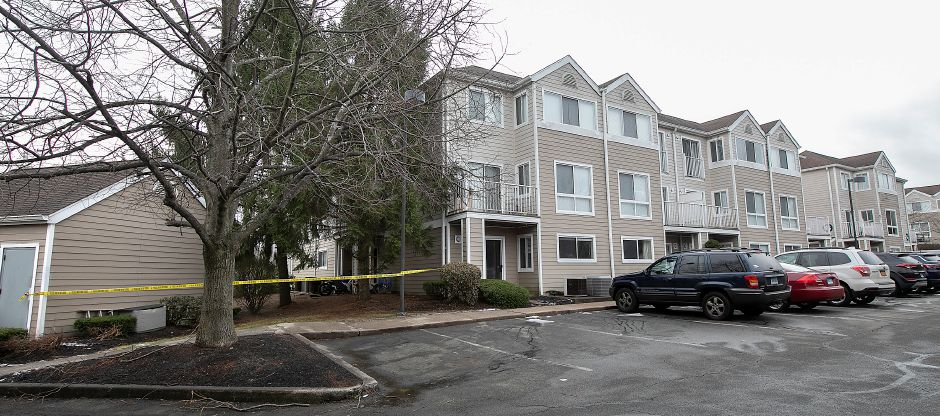Police tape blocks off an area next to Building 8 at Flats at 390 on Bee Street in Meriden on Dec. 27. Police were investigating after gunshots were fired at the apartment complex on Dec. 26. Dave Zajac, Record-Journal