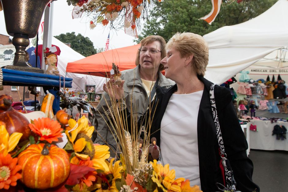Diane Markie of Farmington left and Carol Zimmer of Southington stop at a fall decor booth Sunday during the Apple Harvest Festival in Southington October 8, 2017 | Justin Weekes / For the Record-Journal