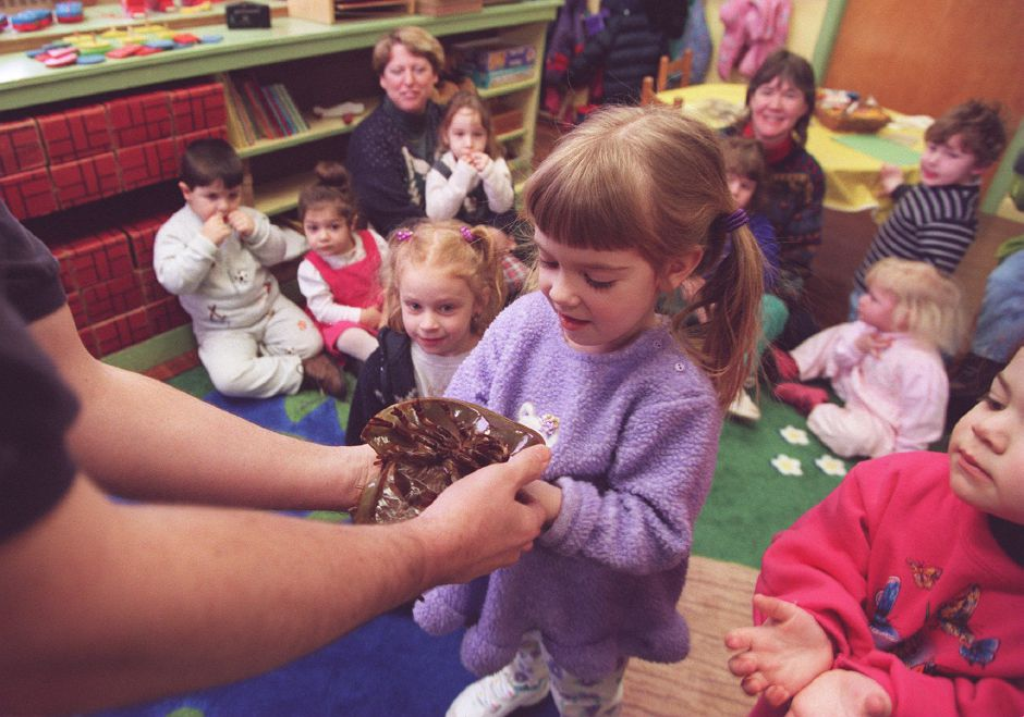 RJ file photo - Jennifer DuBois, 4, of Meriden, is handed a horseshoe crab and Ashley Chase, 2, right, of Middletown waits to get the crab during a program to teach children at the First Congregational Church in Meriden about creatures of the ocean, March 1999.