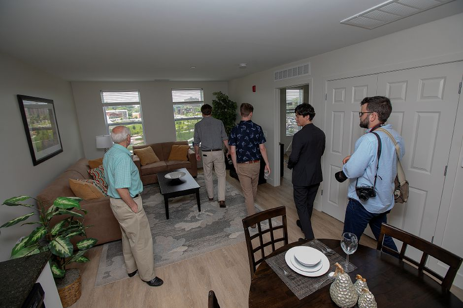 Local officials and guests tour a model apartment in  Meriden Commons I.