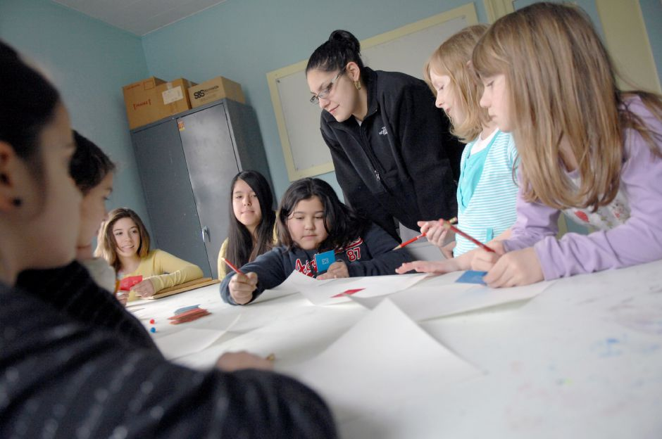 MERIDEN, Connecticut - Wednesday, March 11, 2009 - Local young girls play Pictionary during an after school progam called