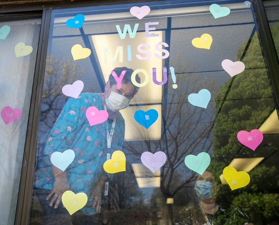 "Secretaries Dael Szypulski, top, and Catherine Vega, bottom right, decorated their office window with a ""We Miss You"" message to students at Casimir Pulaski Elementary School in Meriden, Tues., May 5, 2020. Gov. Ned Lamont has closed schools for the rest of the academic year due to the coronavirus pandemic. Dave Zajac, Record-Journal"