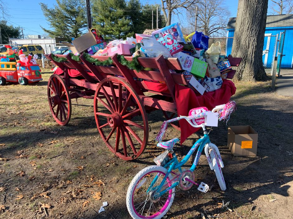 The North Haven Fair Association loaded donated toys and food into a large red carriage that greeted guests as they walked onto the fairgrounds. Photo by Everett Bishop, North Haven Citizen.