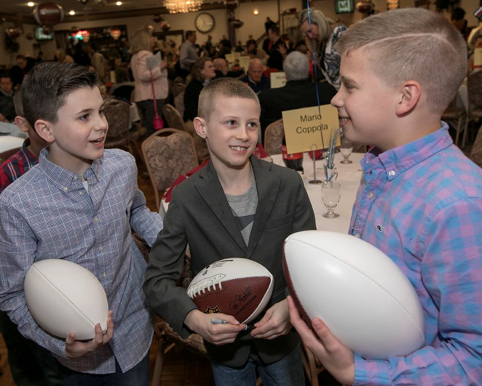 Left to right, Jack Brooder, 9, Tucker Larson, 9, and Brady Rossacci, 10, all of Wallingford, wait to get autographs during the 2018 United Way NFL Players