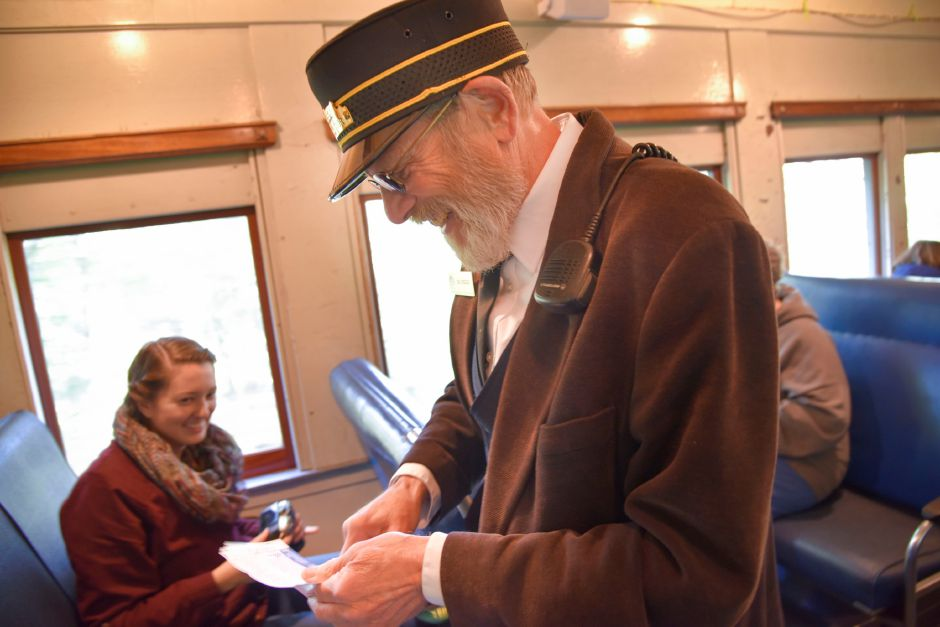 Car Host Bill Dressler checks tickets on the Naugatuck Railroad in Thomaston on Saturday, Oct. 5, 2019. The train included a stop at a private pumpkin patch. | Bailey Wright, Record-Journal