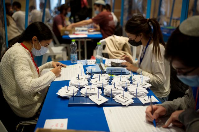 Workers count votes in Israel