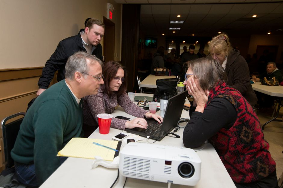 Jeffery Knockerbocher left and Robin Hettrick enter in results with Gina Morgenstein Tuesday during Election Night in Wallingford November 7, 2017 | Justin Weekes / For the Record-Journal