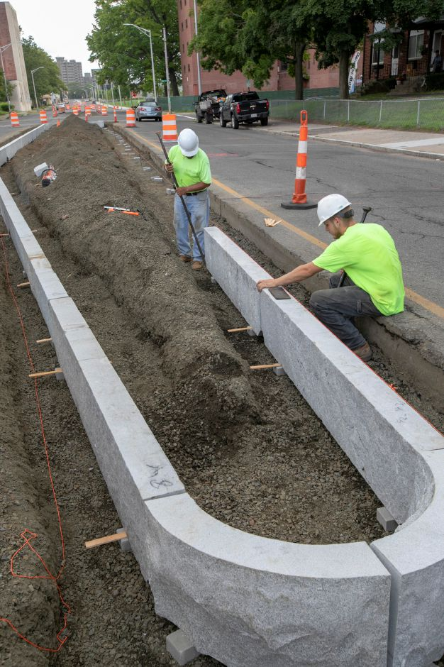 "Crews from LaRosa Construction set in a section of a new median on Pratt Street as construction continues on a boulevard-style ""gateway"" to downtown Meriden, Wednesday, August 1, 2018. Dave Zajac, Record-Journal"