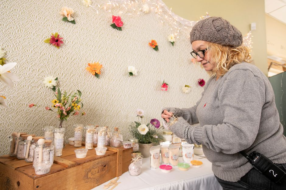 Sandy Nieves, owner of Enchanted Soapstress, which makes and retails organic bath and body products, sets up her shop at 1-3 Colony St. in preparation for a downtown preservation and development conference in Meriden, Wed., Nov. 13, 2019. The Making Meriden Business Center in partnership with CT Main Street Center, the city and others will host the preservation and development conference Thursday at the Silver City Ballroom, 16 Colony St. Dave Zajac, Record-Journal