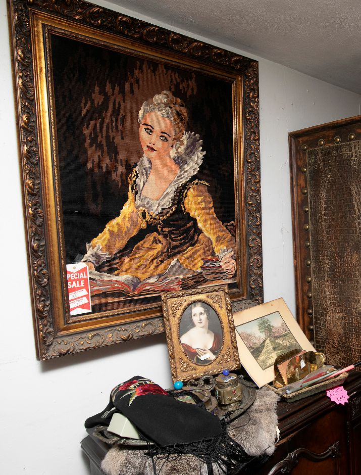 A vintage needlepoint portrait for sale at La Vita Vintage, 774 S. Main St., Plantsville, Mon., Jan. 13, 2020. Shoppe owner Marcy Mongillo is closing the store after 22 years in downtown Southington and Plantsville. Dave Zajac, Record-Journal