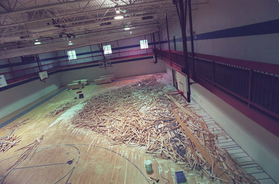 Work has begun to replace the water- damaged gym floor at the Meriden YMCA, July 1999.