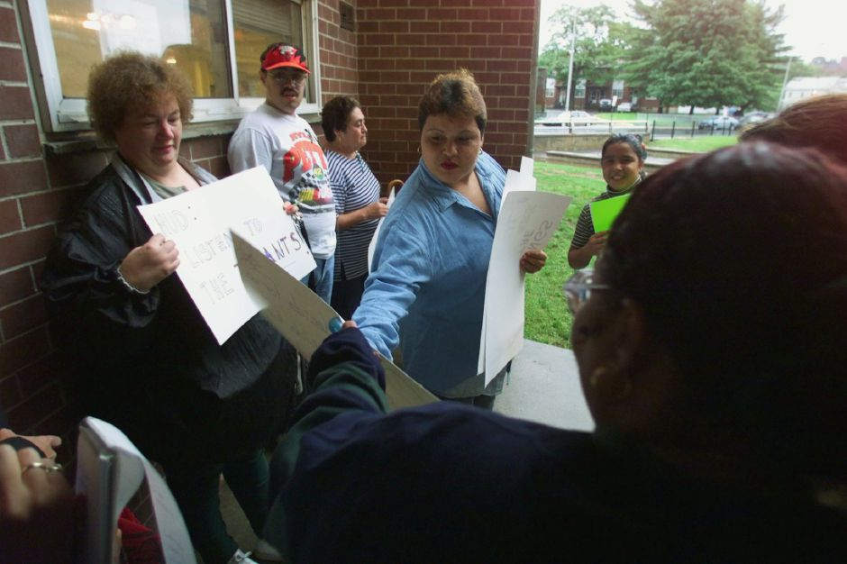 Signs are passed out before the Mills Study Committee meeting outside of the Mills Community Room Tues., Sept. 21, 1999.