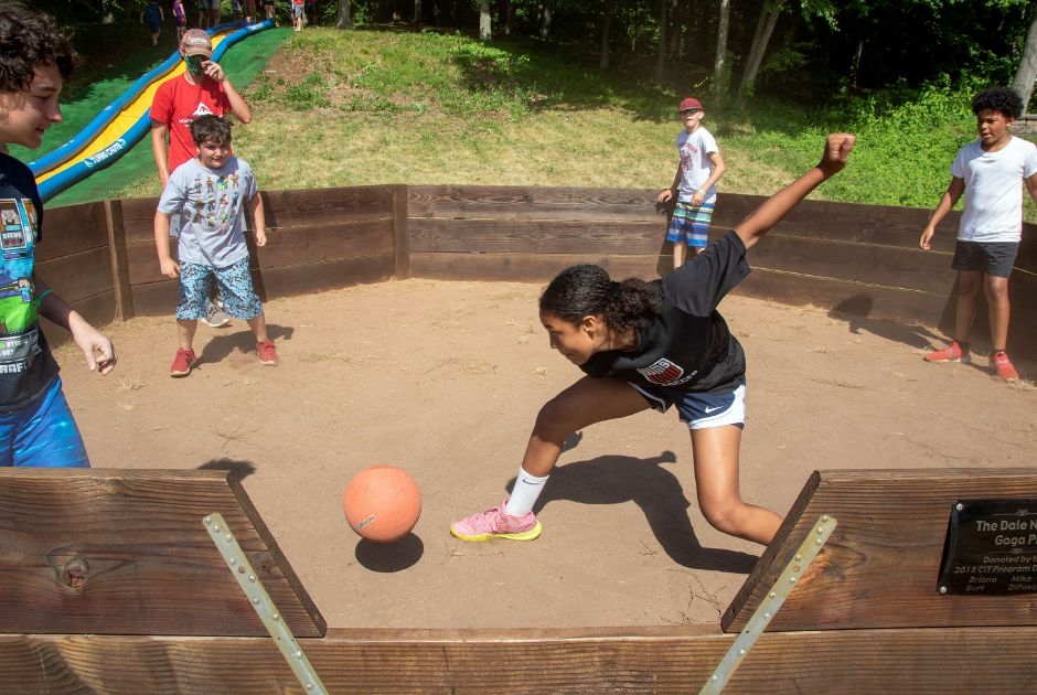 Camper Alex Rhodes 13, gets ready to hit the ball at the Gaga Pit during a game at the Meriden YMCA's Mountain Mist Day Camp on Friday, June 26, 2020. Each group has their own sports equipment and cleaning supplies that they use to disinfect the equipment. Aaron Flaum, Record-Journal