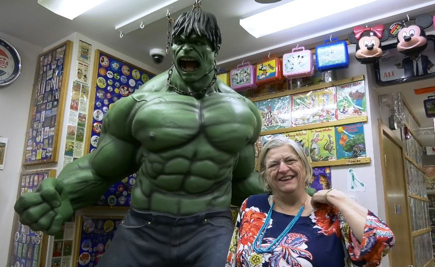Ursula Vinke, museum docent, stands next to the Hulk at the Barker Character, Comic and Cartoon Museum, at 1188 Highland Avenue in Cheshire. Photos by Ashley Kus, Record-Journal