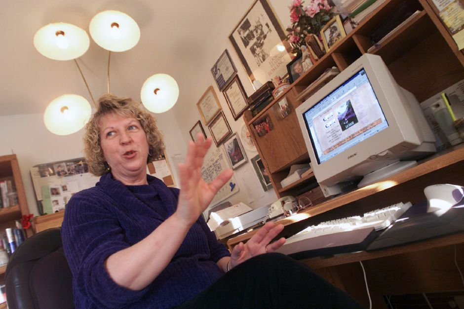 "Lori Avocato, a novelist, sits at her working desk in her Meriden home. Avocato is publishing electronic books. These are sold either online, through the internet, or by disc. Her latest work is called ""Makeshift Family."" Jan. 2001"