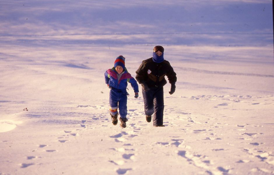 RJ file photo - Mitchell Welch, 6, left and his friend Mark Theriault, 10, both bundled up against the frigid cold, race through the fields at Mitchell