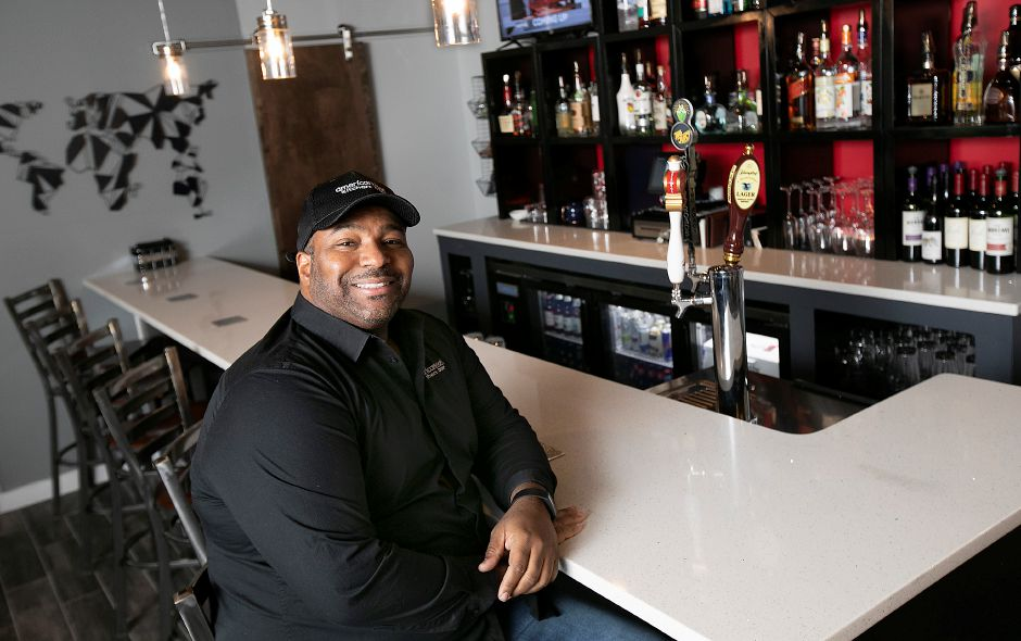 Richard Pennyman, owner of Americansoul Kitchen and Bar, sits at the bar of his restaurant  at 164 Scott St. in Meriden on  Nov. 12.