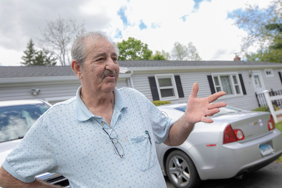 John Argo talks about repairs to his 103 Pond Hill Rd. residence in Wallingford after last year