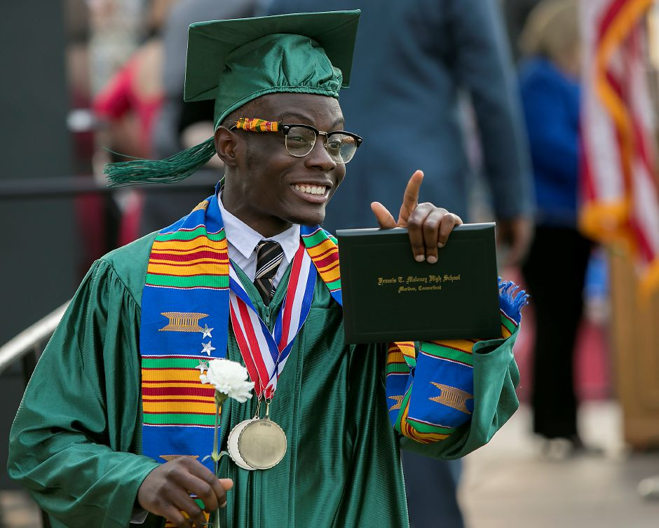 Graduate, Frederick Anti, shows off his diploma to family memnbers during graduation ceremonies at Maloney High School in Meriden, Tuesday, June 13, 2017. | Dave Zajac, Record-Journal