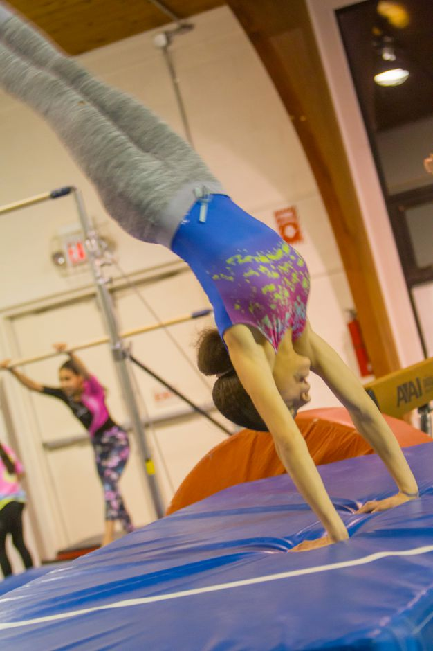 Estrella Delacruz perfecting her moves in Girls Inc. Team Gymnastics Class.| Ron Paris, Special to The Record-Journal