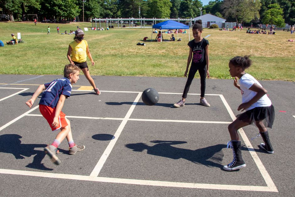 Camp counselor Britney Felix, back left plays a game of Four-Square with her campers Benny Dean 8, front left, Charista Protee 10, back right and Zariah Atwater 10 as they wait for the morning announcements at Meriden YMCA's Mountain Mist Day Camp on Friday, June 26, 2020. Aaron Flaum, Record-Journal