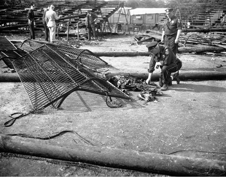 Police inspect one of the wild animal runways of the Ringling Bros. and Barnum and Bailey Circus, which, witnesses said, prevented some of the show's patrons from escaping the flames that razed the big top at Hartford, Connecticut, July 6, 1944, resulting in the deaths on more than 120 persons.  (AP Photo)