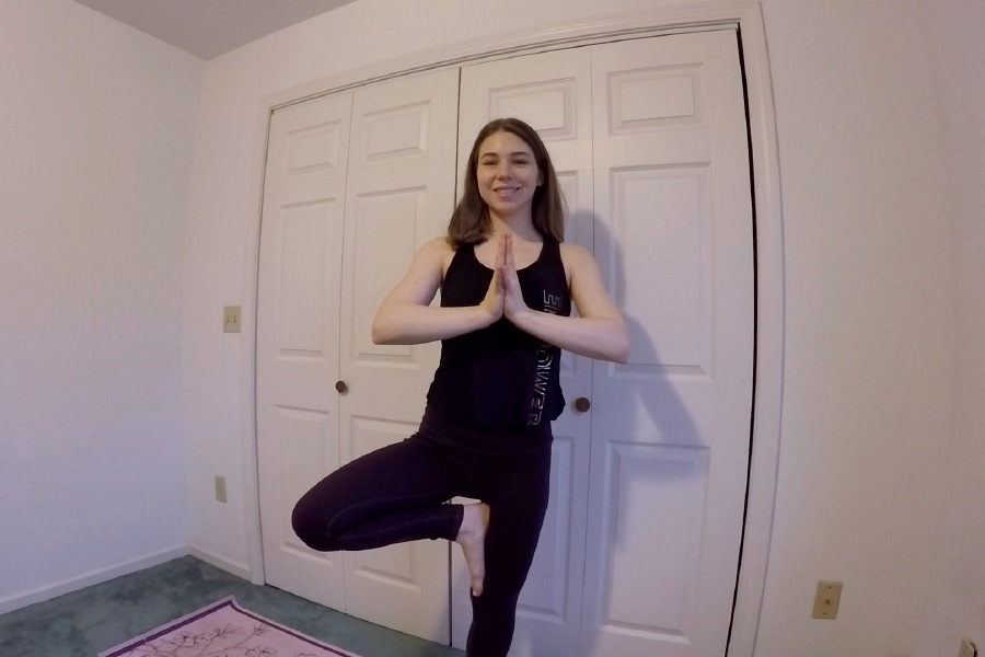 Kristen Dearborn demonstrates a tree pose perfect for yoga beginners to practice at home.