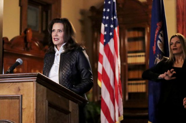 In a photo provided by the Michigan Office of the Governor, Michigan Gov. Gretchen Whitmer addresses the state during a speech in Lansing, Mich., Thursday, Oct. 8, 2020. The governor delivered remarks addressing Michiganders after the Michigan Attorney General, Michigan State Police, U.S. Department of Justice, and FBI announced state and federal charges against 13 members of two militia groups who were preparing to kidnap and possibly kill the governor. (Michigan Office of the Governor...