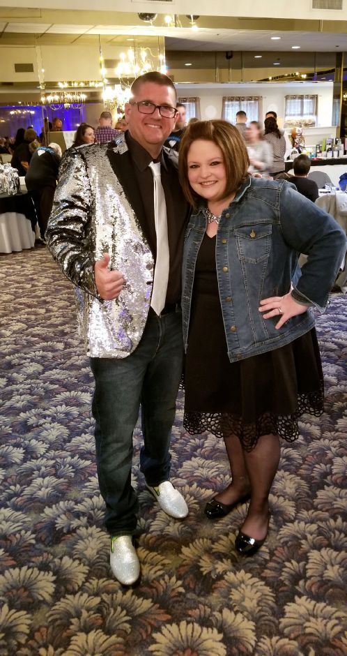 Auctioneer and parent, BJ Kogut, wears his bling beside Principal Christa Chodkowski in denim.