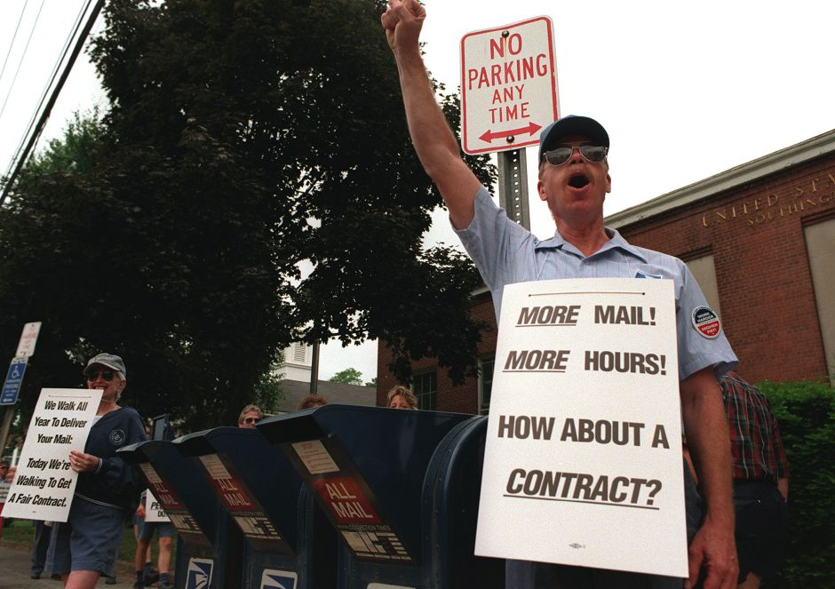 Letter carrier Dick Rose pickets outside the Southington Post Office, with his wife Judy June 9, 1999.