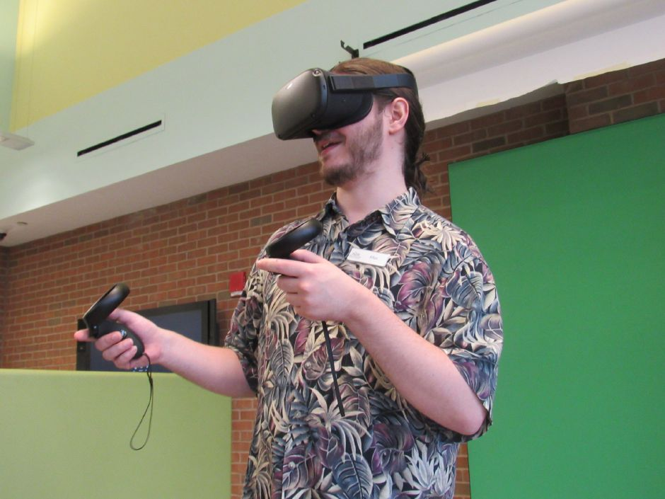 Max Spurr, creative technologies librarian, uses the Oculus Quest,  virtual reality system, in the Collaboratoy. Virtual Summer is a new program for teens available this summer at the Wallingford Public Library.Thursday, June 20, 2019. Photos by Jeniece Roman, Record-Journal