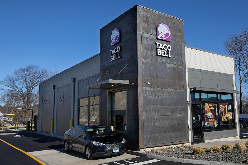 A drive-thru customer receives an order at the new Taco Bell at 467 W. Main St. in Meriden,Tues., Dec. 18, 2018. Dave Zajac, Record-Journal