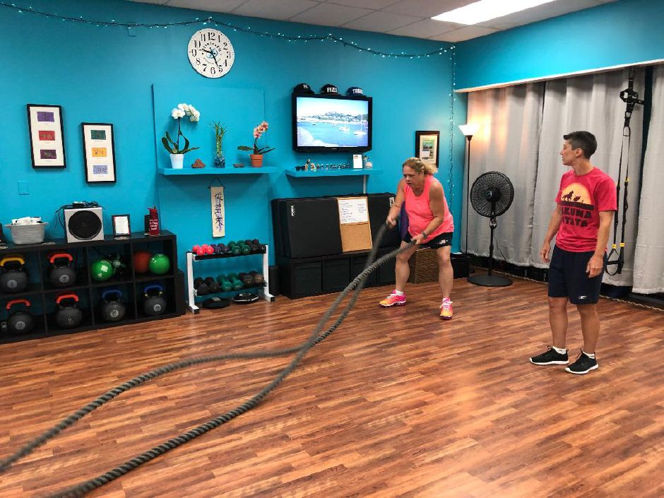 Linda Gilbert uses the battle ropes at Main Street Wellness Studio, Wallingford. |Kristen Dearborn, special to the Record-Journal