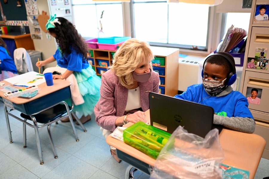 First lady Jill Biden speaks with a student on Wednesday  as she tours Benjamin Franklin Elementary School in Meriden.