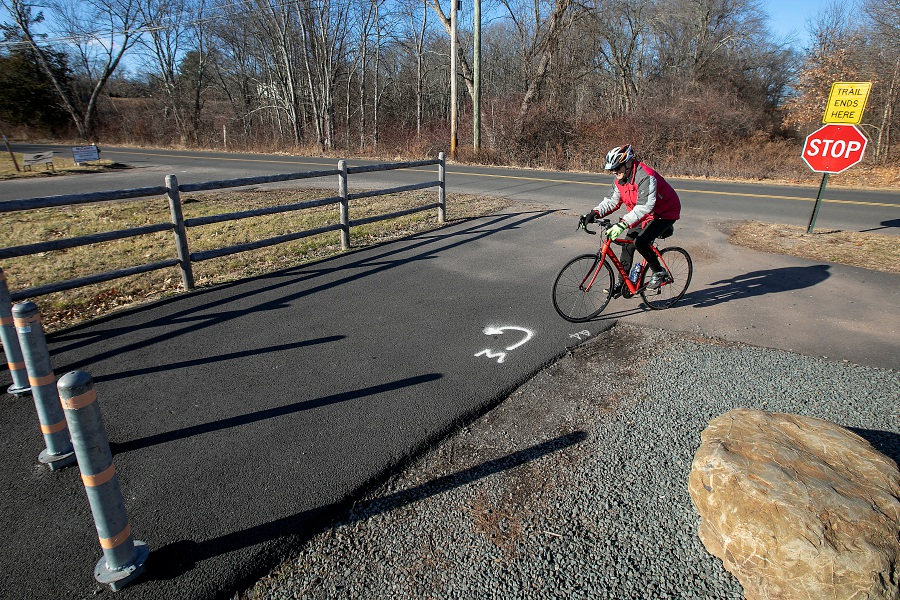 A bicyclist turns around Wednesday at the end of the Farmington Canal Heritage Trail at Lazy Lane in Southington. Lawmakers are proposing to develop the Central Connecticut Loop trail, a 110-mile long multi-use trail that would run through parts of Southington and Meriden. Dave Zajac, Record-Journal