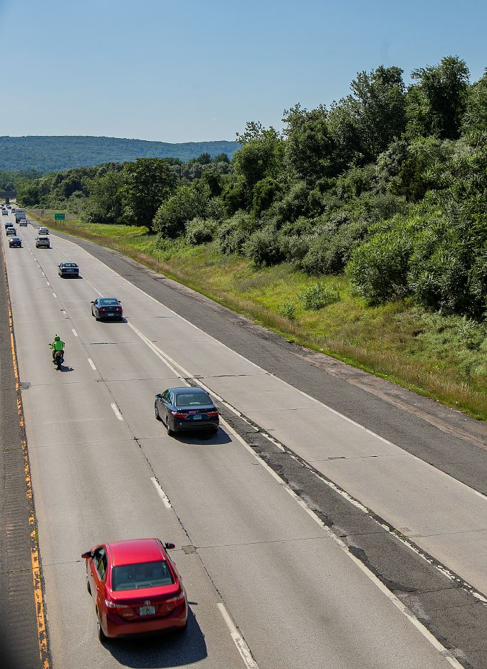 View from the Highland Avenue bridge shows motorists traveling west on Interstate 691 in Cheshire, Wednesday, July 18, 2018. The wooded area, right, is being considered for a retail, housing and office space development. Dave Zajac, Record-Journal