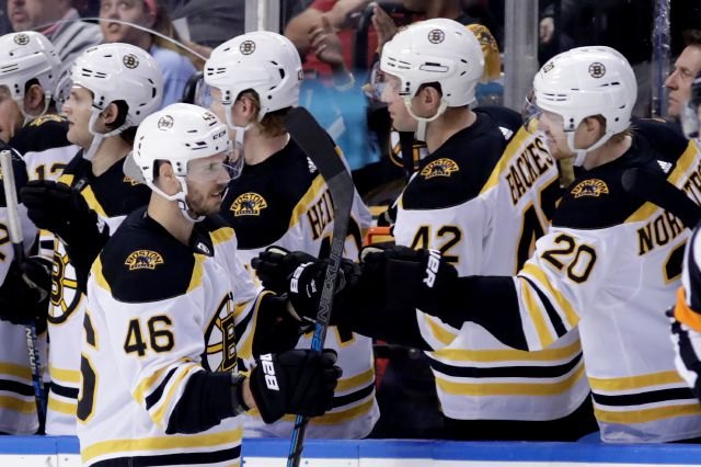 Boston Bruins center David Krejci (46) is congratulated after scoring a goal during the second period of an NHL hockey game against the Florida Panthers, Saturday, Dec. 14, 2019, in Sunrise, Fla. (AP Photo/Lynne Sladky)
