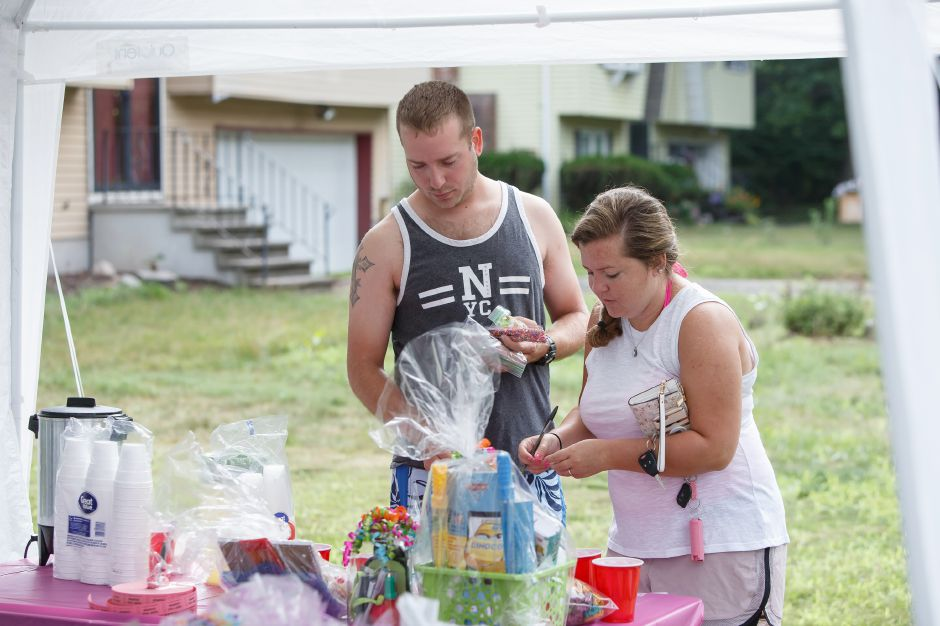 David Bolles and Jacqueline Sheltman of Wallingford makes a selection for the raffle Saturday during the 6th Annual childrens book drive to benefit Read to Grow July 28, 2018 | Justin Weekes / Special to the Record-Journal