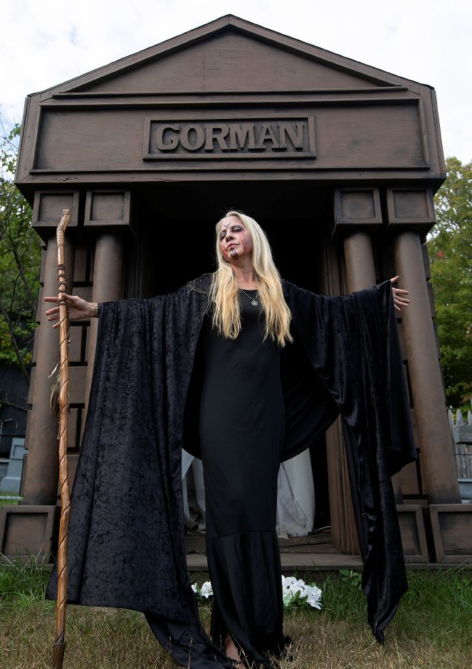 Draped in black velvet, Erika Allen, of Thomaston, plays a witch at this year
