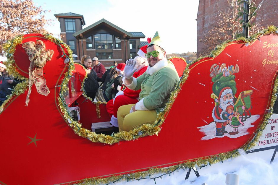 Santa's elf waves from the sleigh outside of the Meriden train station during the annual Yulefest on Saturday, Nov. 30, 2019. Emily J. Tilley, special to the Record-Journal.