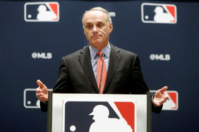 FILE - In this Nov. 21, 2019, file photo, baseball commissioner Rob Manfred speaks to the media at the owners meeting in Arlington, Texas. Major League Baseball rejected the players