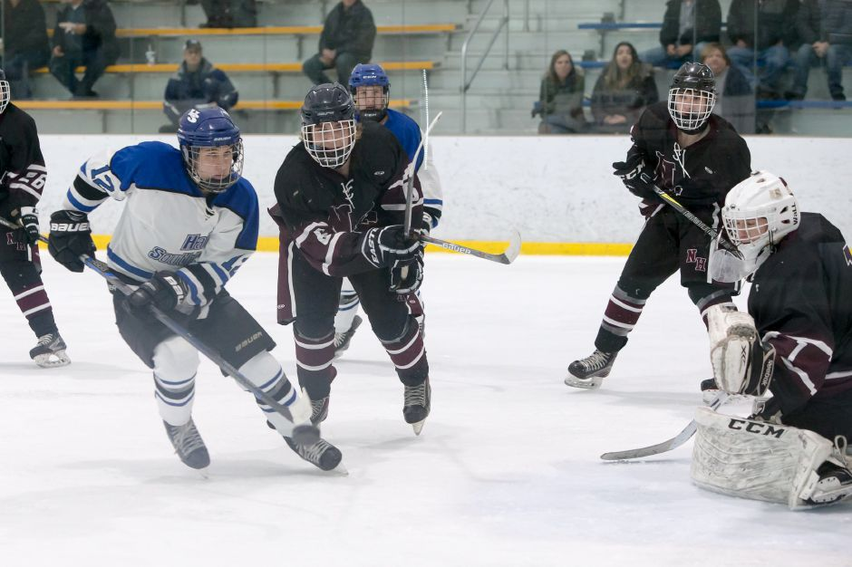 The North Haven hockey team battles Hall-Southington in this 2018 photo. This winter, the North Haven icemen are one of the favorites to claim the SCC/SWC Division II title.