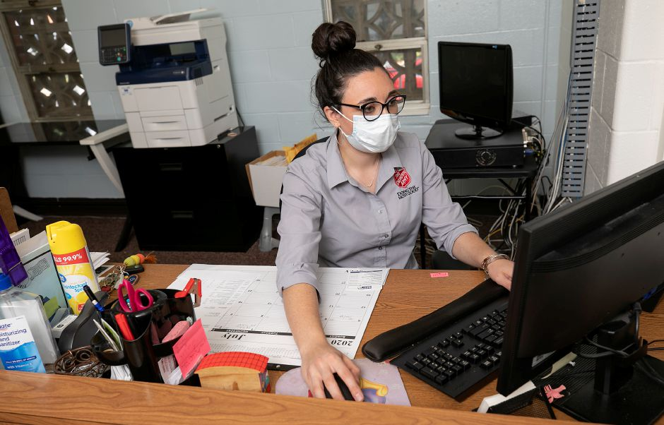 Kate Borrero, corps officer, works at her desk at the Salvation Army in Meriden on  July 2. The numbers of people seeking rental assistance at the Salvation Army  rose from two to three calls per week to 12 to 15 since the start of the public health emergency.File photo, Record-Journal