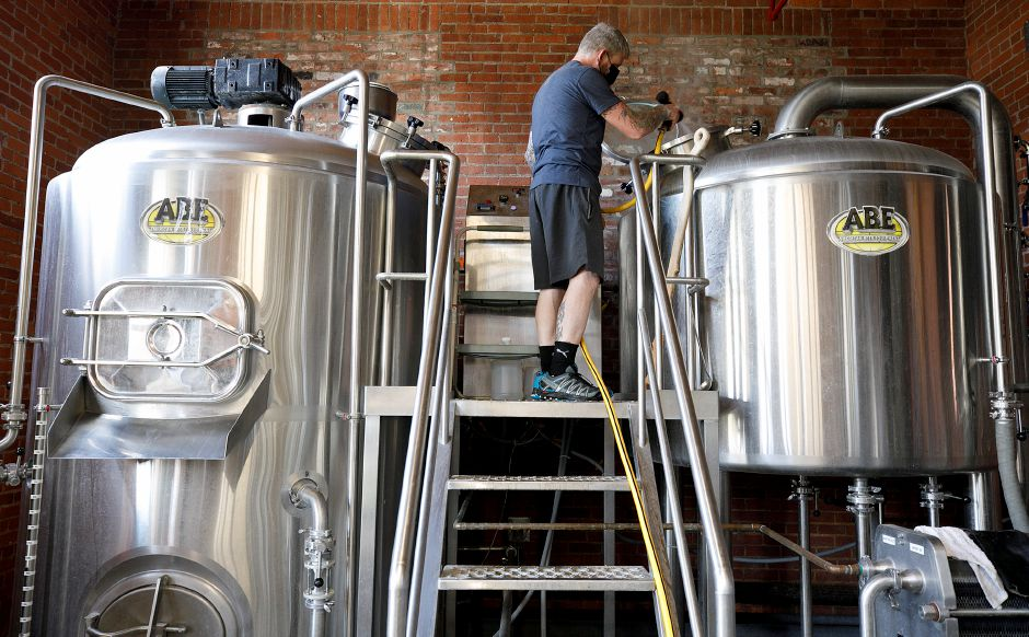 Brewery Manager Robert Todd rinses down a kettle at Witchdoctor Brewing Company in Southington, Tues., Apr. 13, 2021. Witchdoctor Brewing Company is planning an expansion. Dave Zajac, Record-Journal