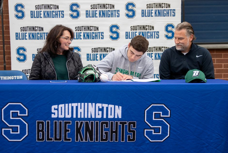 Flanked by his parents Gwen and Chris, Southington's Devan Bade signs a National Letter of Intent to play baseball at New York's Binghamton University. Aaron Flaum, Record-Journal