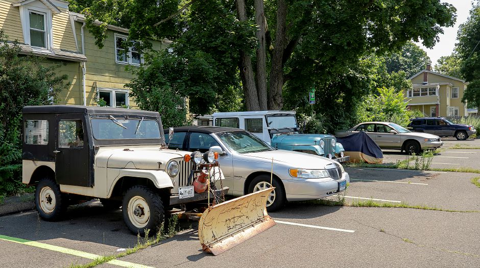 Vehicles parked in public spaces in Public Lot 3 located between William Street and Meadow Street in Wallingford, Thurs., Jul. 9, 2020. Several town officials are considering new parking rules aimed at discouraging long-term parking. Dave Zajac, Record-Journal