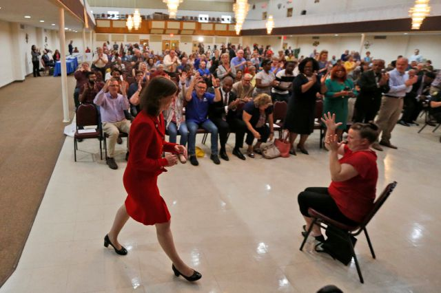 Rep. Elaine Luria, D-Va., front left, arrives for a town hall at a church in Virginia Beach, Va., Thursday, Oct. 3, 2019. Luria recently joined a group of other Congresswomen to call for the impeachment of President trump. (AP Photo/Steve Helber)