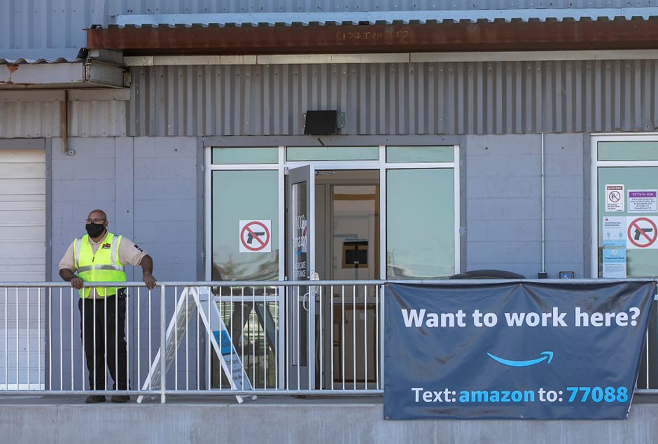 A man stands at the entrance to Amazon Logistics which has opened at 425 S. Cherry St., Wallingford, Wed., Aug. 26, 2020. Amazon Logistics is a shipping and delivery service that uses third-party contractors to pick up and deliver customer orders. Dave Zajac, Record-Journal